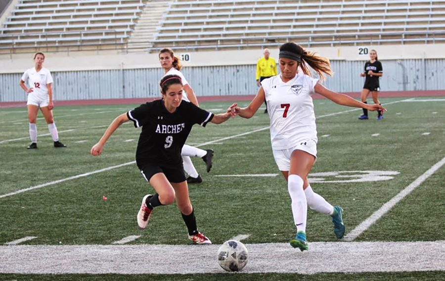 Junior Ariana Gola (left) battles for the ball against a Grace Brethren player at Santa Monica College on Dec. 21.