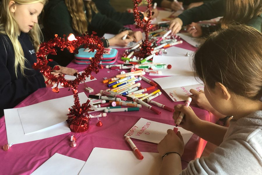 Students decorate Valentine's day cards during the Best Buddies dance party.