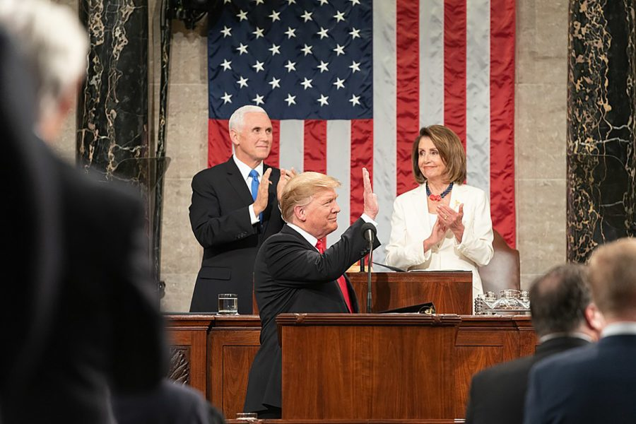 Speaker of the House Democrat Nancy Pelosi claps after one of Trump's remarks with Mike Pence to her left at the State of the Union Address  in Washington D.C. on Feb. 5. At another point in the speech, Pelosi clapped in a way that many interpreted as sarcastic. Trump has not responded to the virality of Pelosi's gesture.