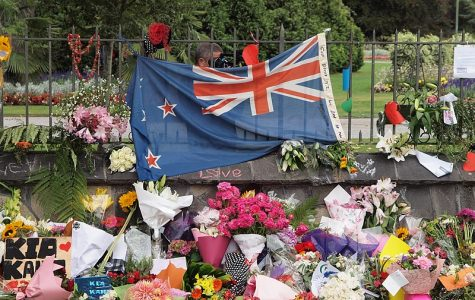 A New Zealand flag surrounded by flowers at the tribute wall set up at the Botanic Gardens.  Archer Student Support Coordinator and Junior Class Dean Jennifer Dohr was