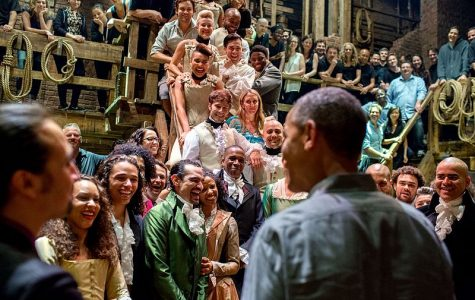 Former president Barack Obama greets the racially diverse cast and crew of
