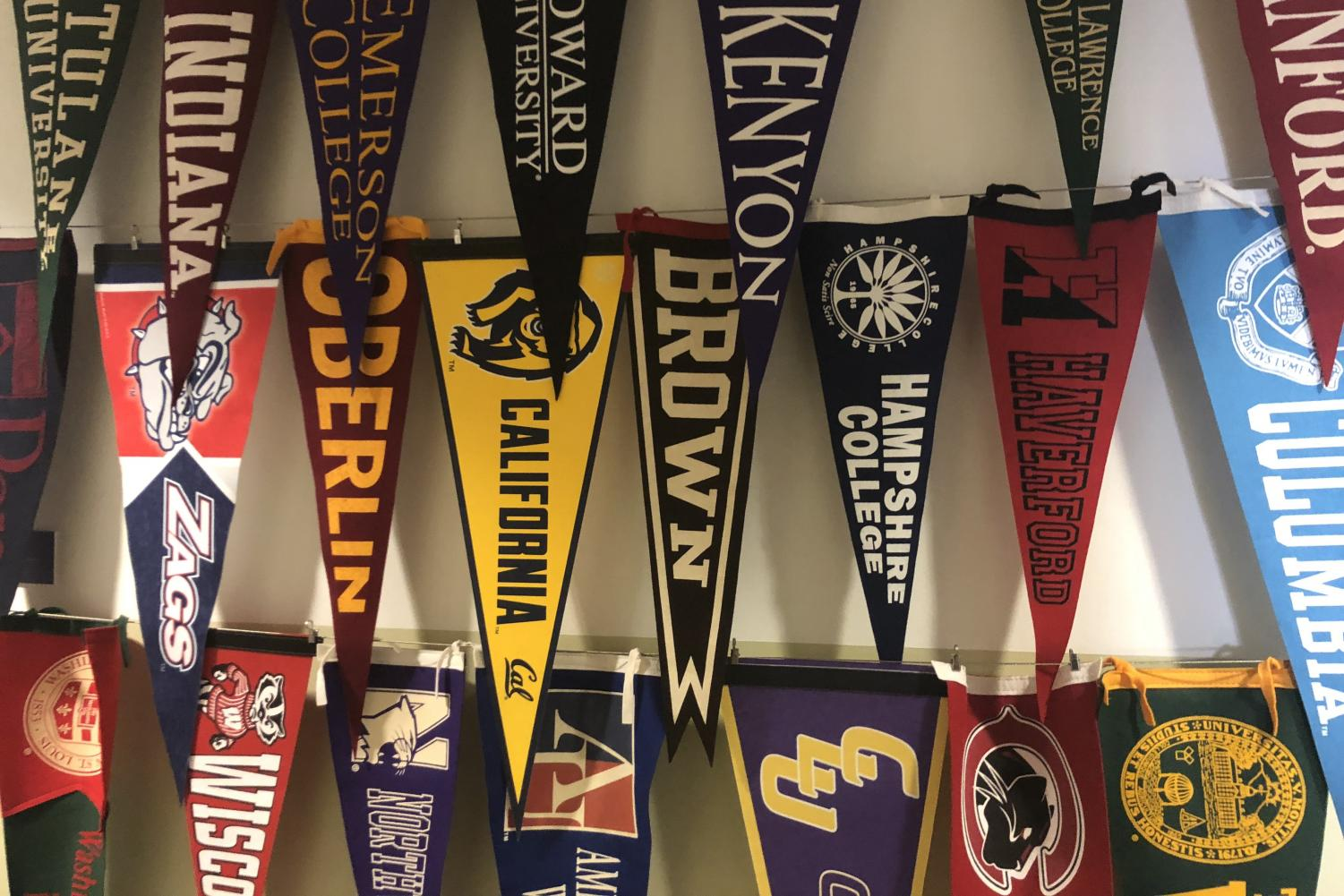 College pennants hang in the hallway. Last Tuesday, top universities including Yale, Stanford and University of Southern California were revealed to be part of a scheme that the FBI dubbed