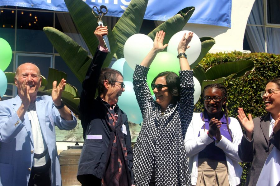 Head of School Elizabeth English and co-founder Diana Meehan, flanked by Board of Trustees chair Frank Marshall, Zoe Griffin '23 and Student Body President Juliet Youssef, cheer immediately after the ribbon-cutting at the ceremony. All Archer students were invited to the stage for the ribbon-cutting.