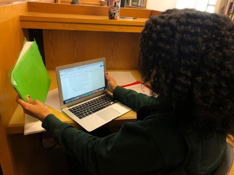 Junior Anaya Thompson completes homework in the individual library cubbies during her free period. Many juniors described this year as