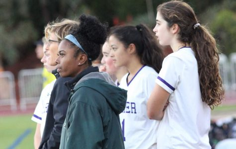 Watching from the sidelines, head soccer coaches Kim Smith and Amelia Mathis observe a varsity soccer game against the Brentwood Eagles on Dec. 6. Smith is currently serving as Acting Athletic Director of the upper school, while Mathis is filling the equivalent postition for the middle school.