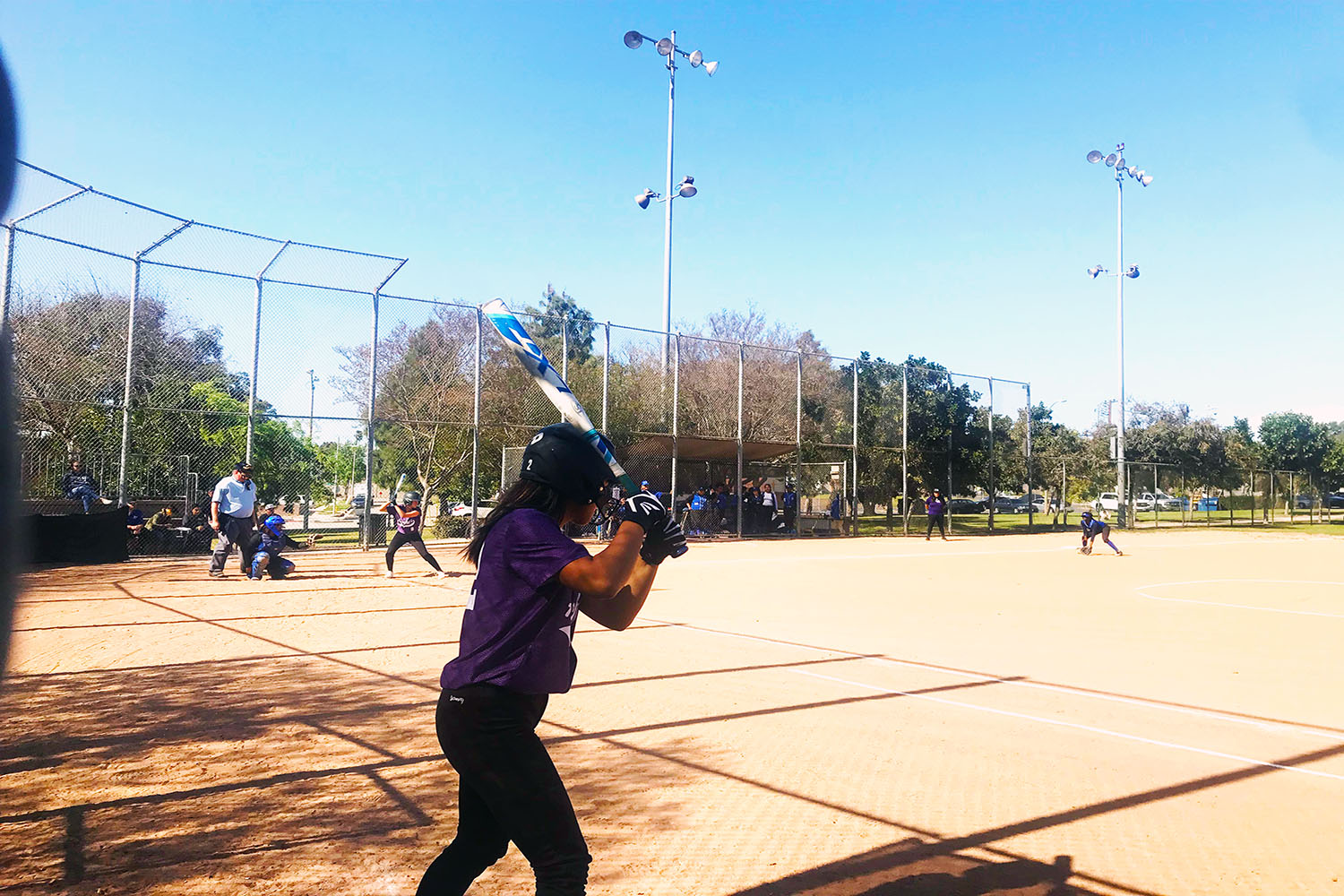 Softball players practice for their game against Hawthorne Math and Science academy.