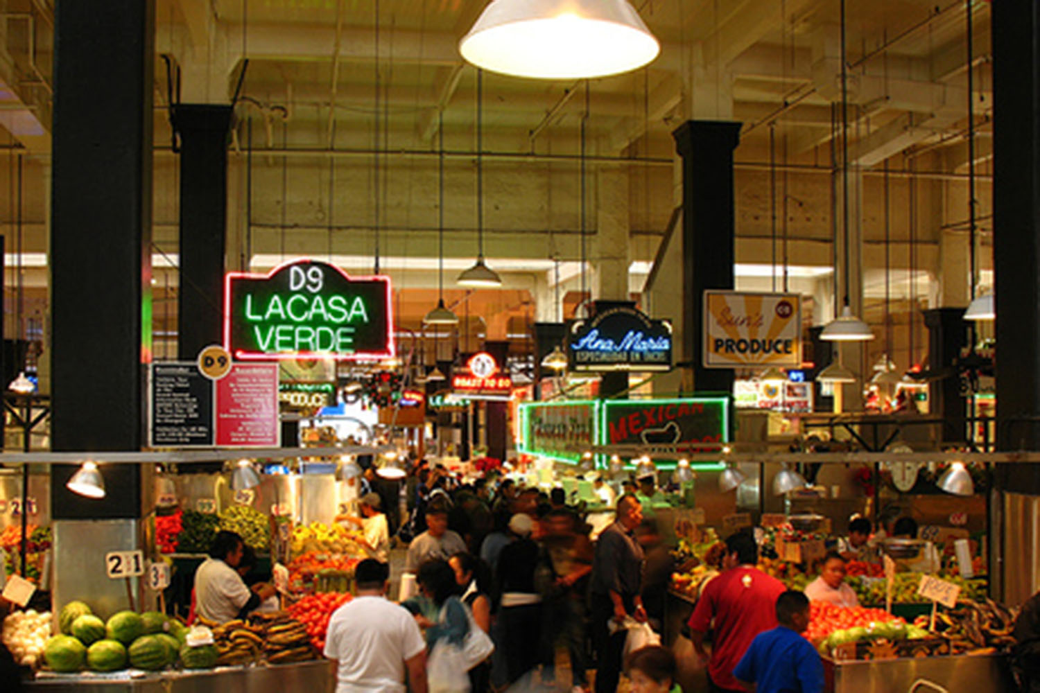 Visitors of Downtown Los Angeles' Grand Central Market check out restaurants. The market is home to more than 30 restaurants and different shops.