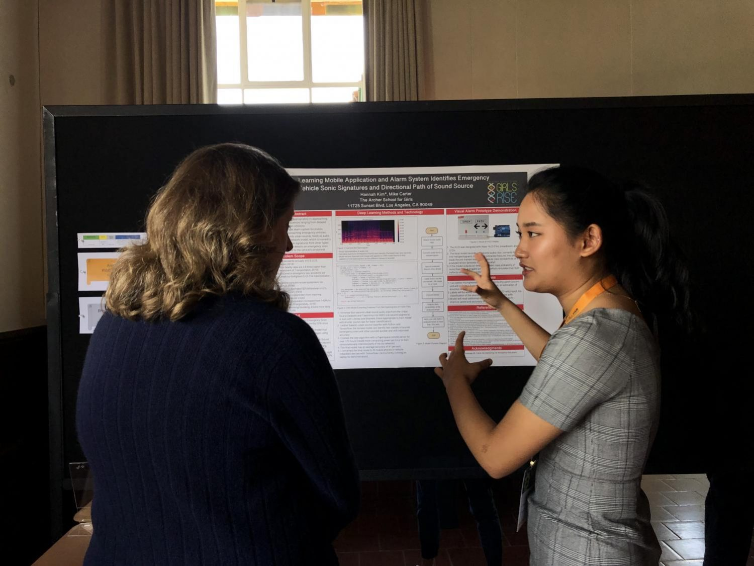 Junior Hannah Kim presents her design for an artificial intelligence mobile application and alarm system that identifies an emergency vehicle's siren. Annually, students present their research in the STEM fields at Archer's STEM conference.