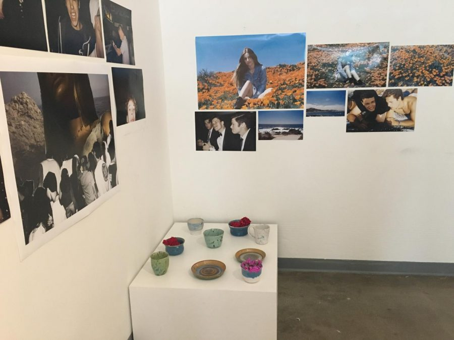Sandy Frank's ceramics sit on a pedestal, while Olivia Woolf's photographs hang on the wall. Though their art shows were separate, both seniors' shows discussed leaving home and entering a new chapter in their lives.