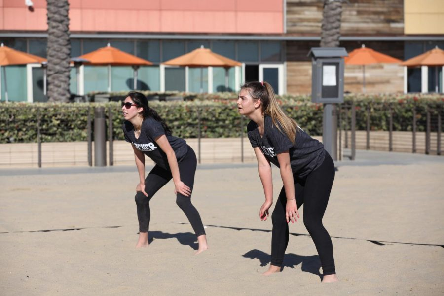 Seniors Stella Smyth (left) and Jenna Marks (right) participate in a match. The Beach Volleyball seniors have been described as