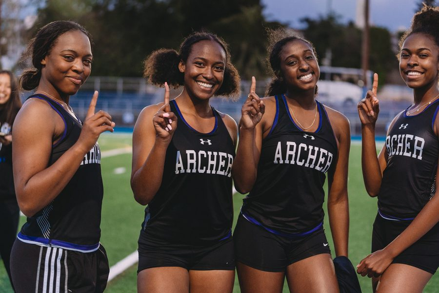 Gianna Parks, Hailey Adams, Starr Brown and Nia Mosby smile after winning the 4x100 relay at their last league meet of the season. Mosby said that the group had just gotten one of their best times.