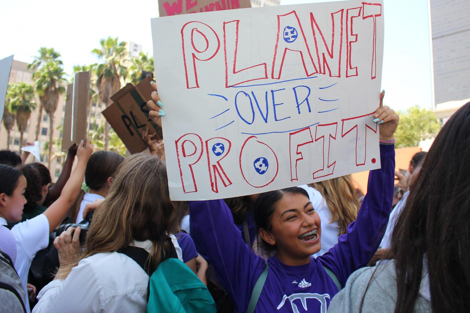 Destiny Morado '22 cheers at the Los Angeles Global Climate Strike. She said she was grateful to attend the event with Archer.