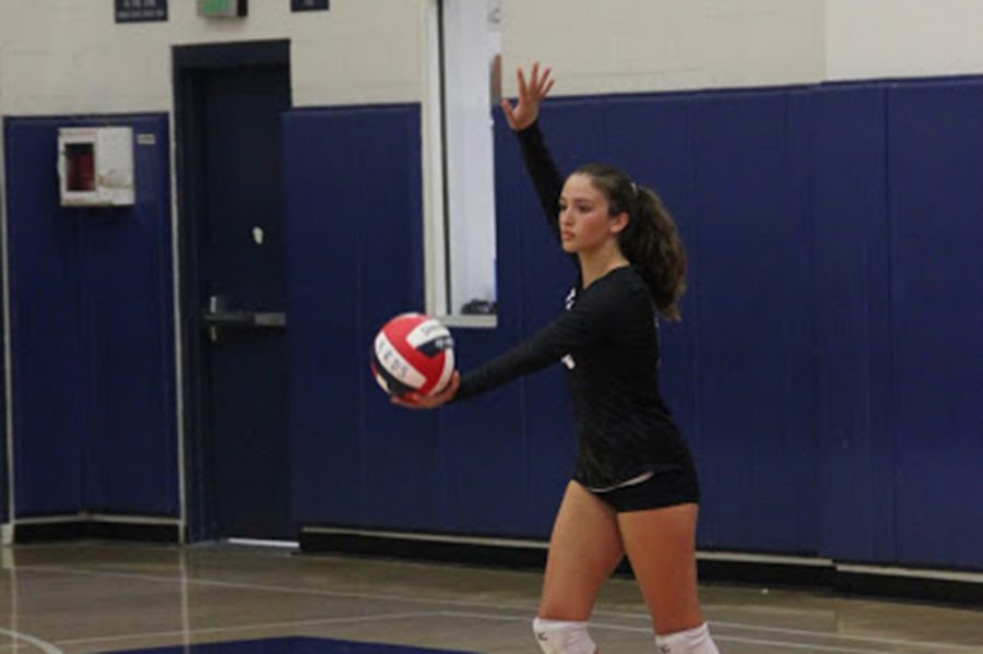 Bella+Morgan+prepares+to+serve+in+a+game+against+Crossroads+in+September+2018.+On+top+of+playing+volleyball+since+the+age+of+9%2C+Morgan+makes+ceramics+in+her+free+time.+Photo+courtesy+of+Marlee+Rice.+