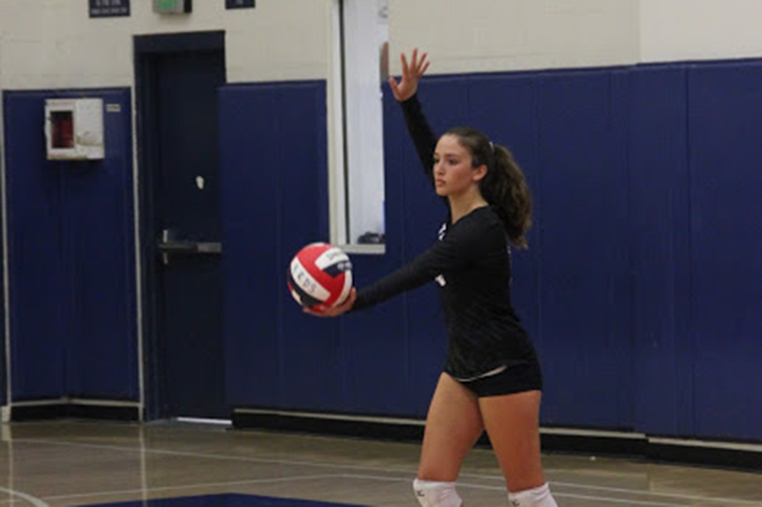 Bella Morgan prepares to serve in a game against Crossroads in September 2018. On top of playing volleyball since the age of 9, Morgan makes ceramics in her free time. Photo courtesy of Marlee Rice.