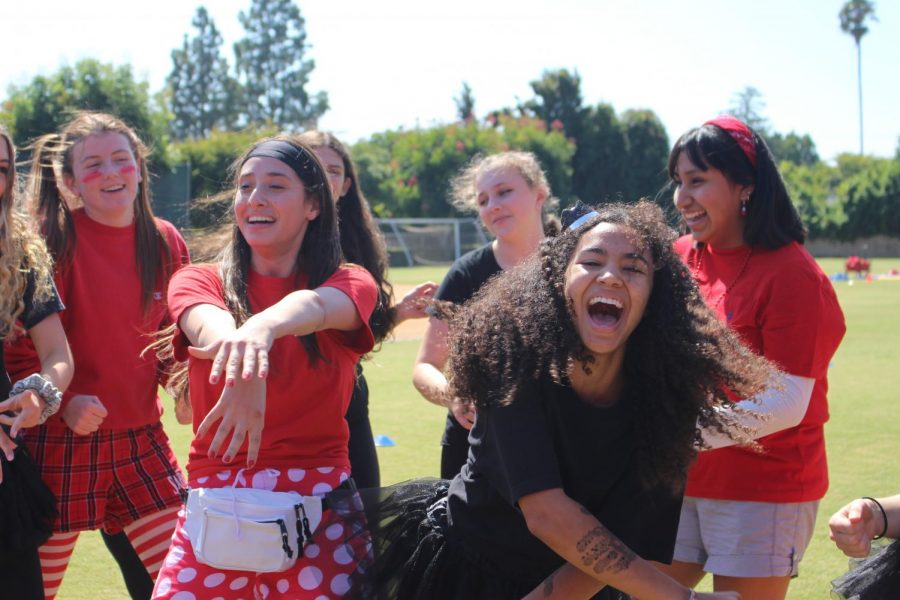 Student council representatives perform a halftime dance. The inaugural event split grades into two teams (red and black) to compete in a number of activities for spirit points.