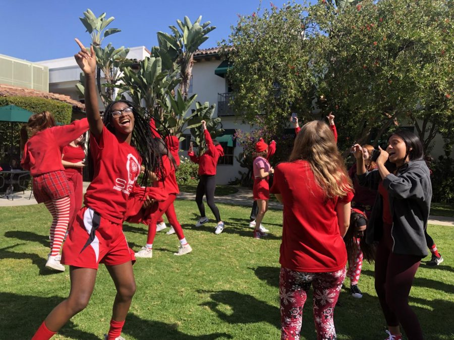 Seniors celebrate their first and last Color Clash in the Courtyard. The inaugural event split grades into two teams (red and black) to compete in a number of activities for spirit points.