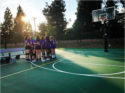 The purple volleyball team, led by sixth grader Juliette Hoeber and seventh grader Callie Wicklander, gathers in a huddle on Archer's Sport Court. The team is composed mainly of new Archer students, and a sense of unity was a main goal for both Hoeber and Wicklander.