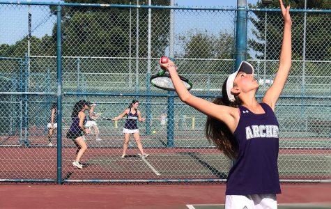 Sophomore Naya Ben-Meir serves a ball at Rancho Park against Marymount High School's tennis team.