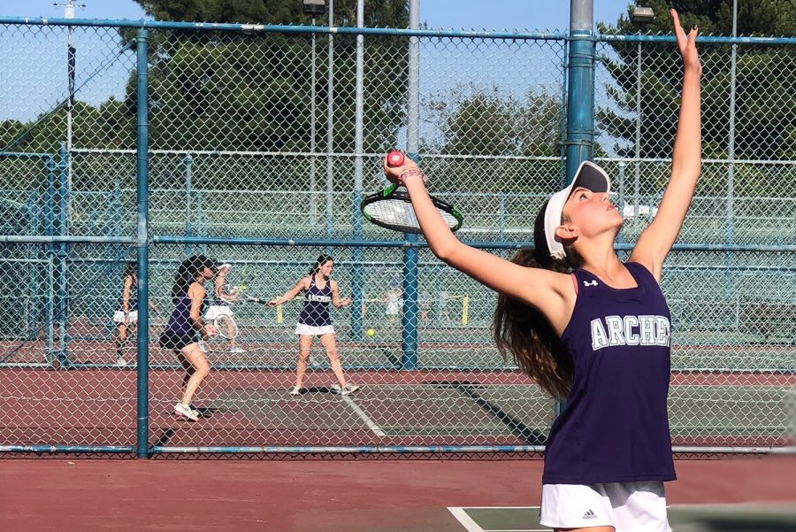 Sophomore+Naya+Ben-Meir+serves+a+ball+at+Rancho+Park+against+Marymount+High+School%27s+tennis+team.+
