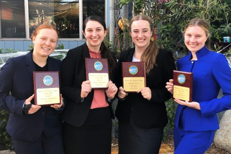 Holding their debate awards, Noa Wallock '22, Rachael Azrialy '21, Kylie Chryss-Connell '21 and Grace Carter '20 pose for a photo after competing in a speech tournament at New Roads School. Azrialy and Chryss-Connell tied for first, Wallock won first in her category and Carter got second.
