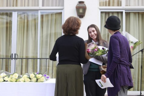 Student Body President and senior Gracie Wilson offers flowers to two of Archer's founders, Vicky Shorr and Diana Meehan. The Archer community gathered in the courtyard on Wednesday, Nov. 6, to recognize the senior class  and celebrate Archer's twenty-fourth year.