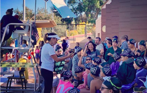 Head Coach Stephanie Ferri advises the Middle School swimmers. The swim team was undefeated this season. Photo courtesy of Archer Athletics' Instagram.