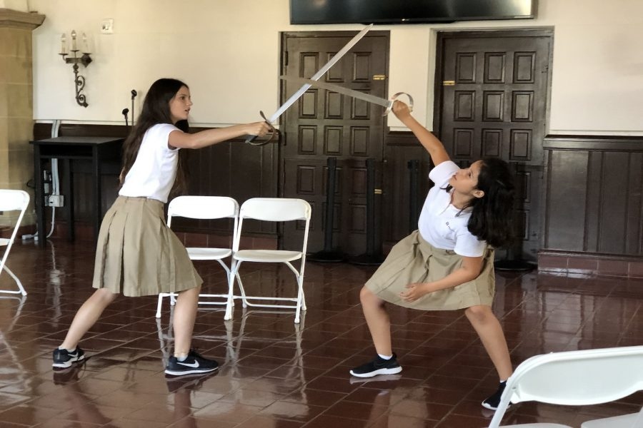 Echo Meadows ('25) and Belén Haro ('26) rehearse a sword fighting routine for the all-school play,