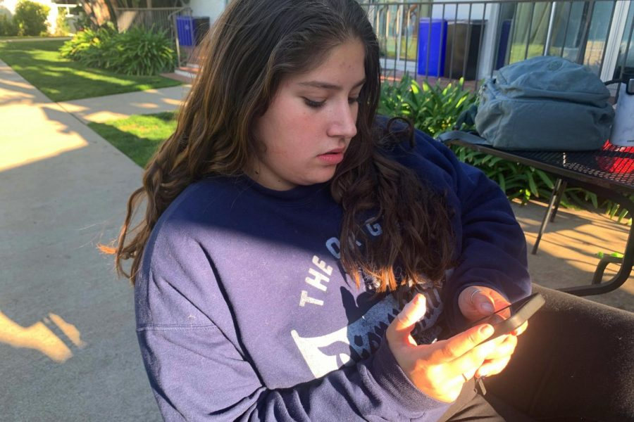Freshman Annabelle Terner sits alone while scrolling through Instagram. Instagram creates pressure to appear a certain way; however, removing likes would help alleviate some of the stress teenage girls can feel surrounding the app.