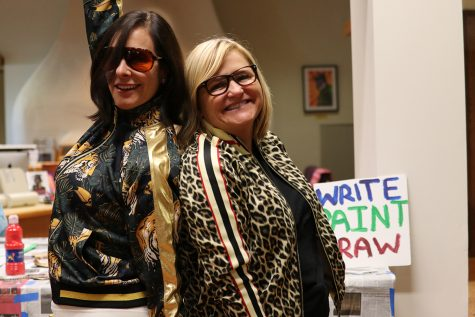 "Ferocious Friday: As part of a new tradition created by English teachers Brian Wogensen and Wendy Deming, Head of School Elizabeth English and Associate Head of School Karen Pavliscak sport ""ferocious"" tiger and leopard print track suits."