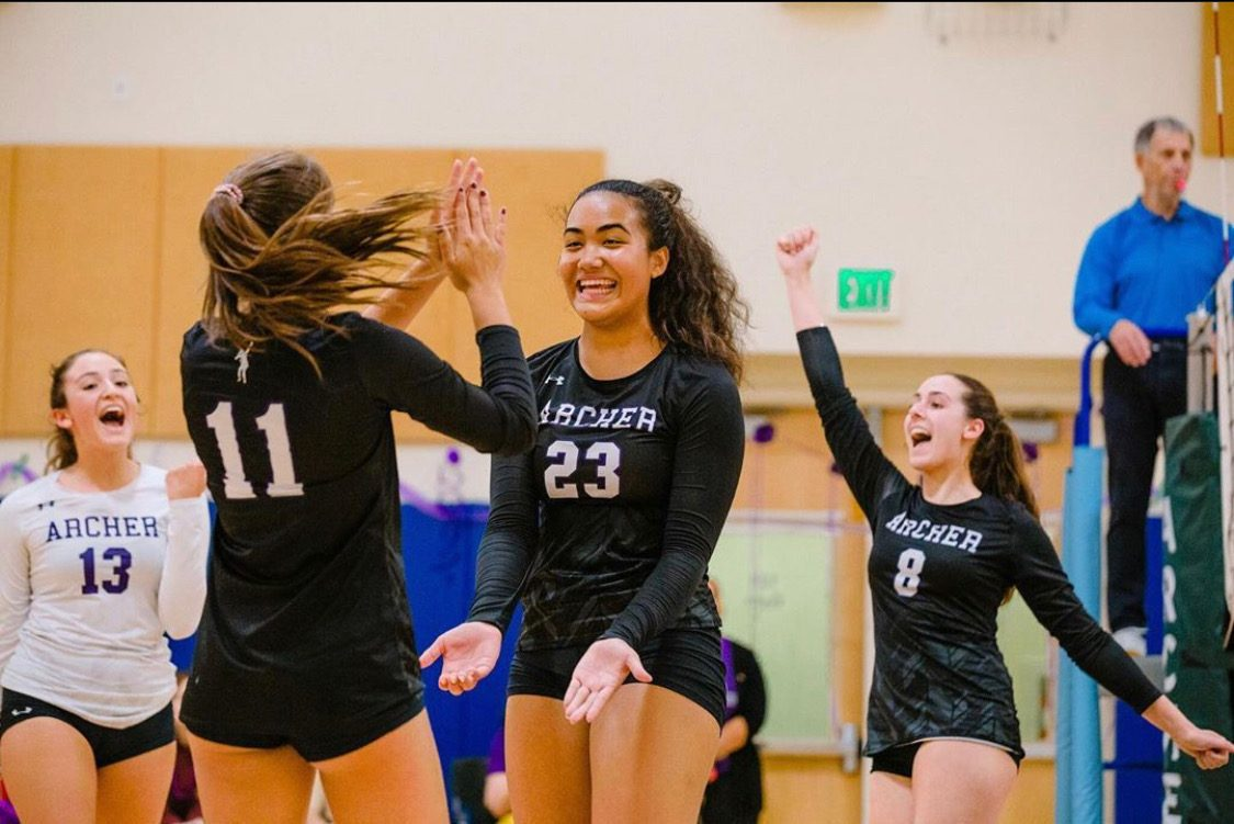 The+varsity+volleyball+team+celebrates+sophomore+Vaughan+Anoa%27i%27s+kill.+%22I+was+super+excited+that+I+could+contribute+to+my+team%2C+which+later+led+to+our+eventual+victory+over+Buckley%2C%22+Anoai%27i+said.+++