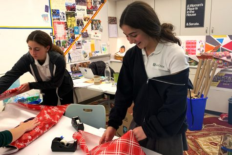 Sophomores Lily Miro and Naya Ben-Meir wrap gifts donated by students during an on-campus gift wrapping session in preparation for Dec. 14. Students will be given the opportunity to hand presents to over 450 families across the Los Angeles area.