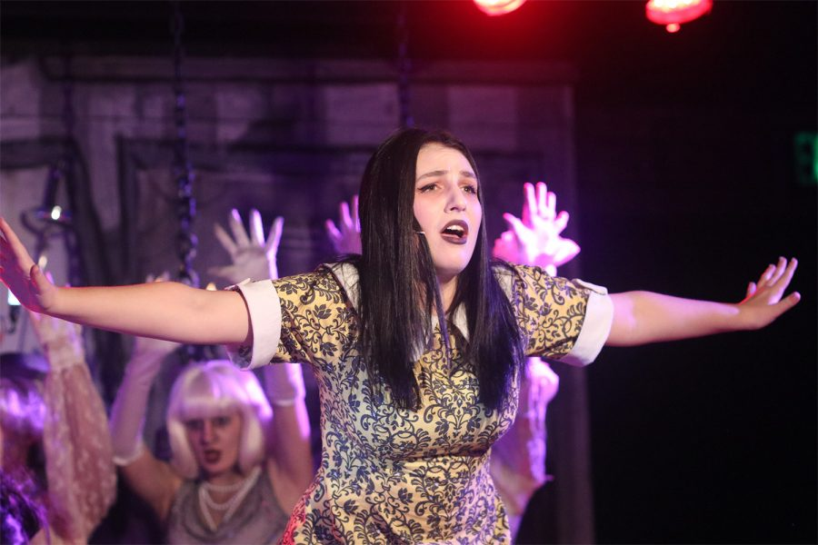 During a dress rehearsal, Willow Stein ('22) sings as the lead character, Wednesday Addams. The central tension in the play revolves around Addams' engagement to the ordinary Lucas Beineke.