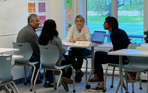 English teacher and journalism adviser speaks with parents along with Admissions Associate, Angela Boulart who was present to be a translator during the conference.