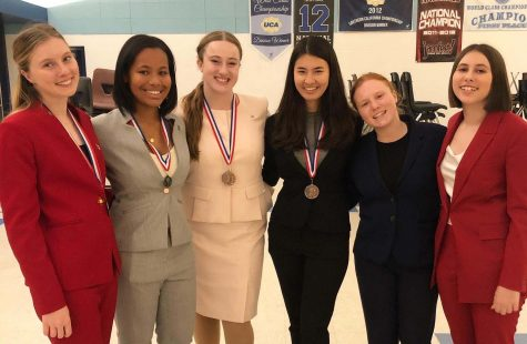 Archer Speech and Debate Team members pose with their awards after a league tournament on Saturday, Nov. 23. Although the team was only officially formed two years ago, Chryss-Connell (third from left) believes that they are