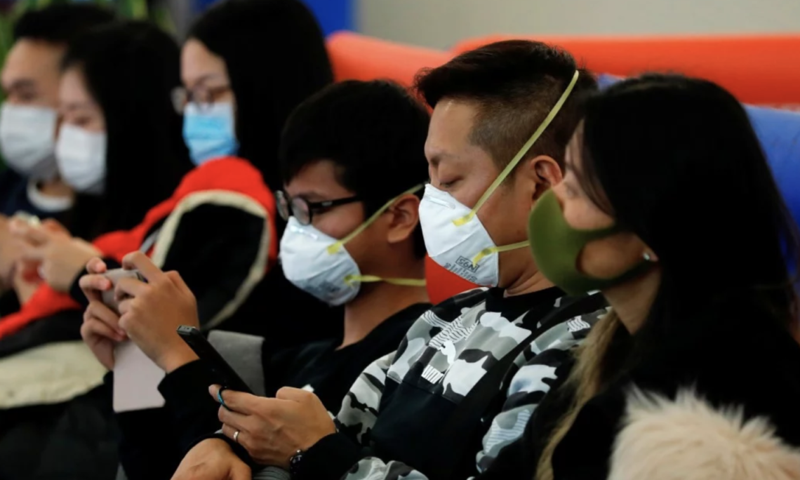 Several people are seen wearing respiratory masks to protect themselves from infection. The U.S. Embassy in Kazakhstan posted this photo on Jan. 24.