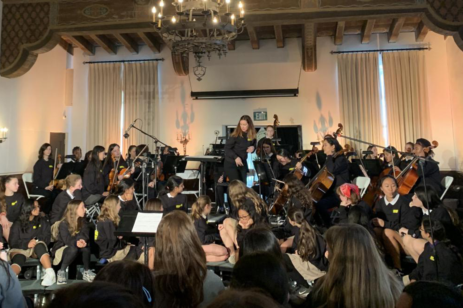 Upper school orchestra prepares to perform the piece