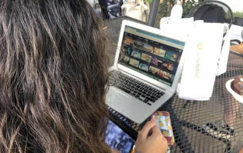 During her free time at school, freshman Maya Kakani explores Disney's new streaming service, Disney Plus, on her school laptop. Disney Plus features old and new shows and movies from not only the Disney universe.