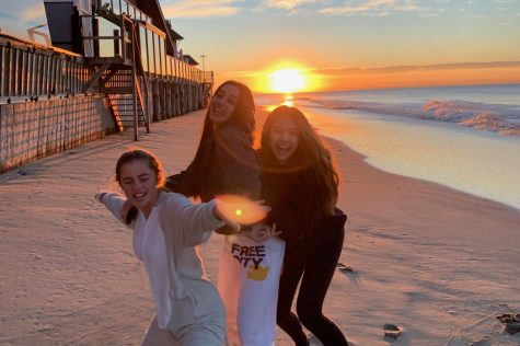 Seniors Grace Wilson, Kelsey Thompson and Charley Griffiths pose on the beach during the first sunrise of the new year. The three girls are celebrating their excitement about having arrived in 2020.