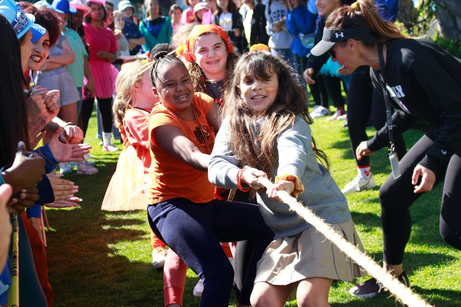 Sixth+graders+Alexa+Grant+and+Lily+Savage+participate+in+the+tug+or+war+competition.+Sixth+grade+wore+the+color+orange.+