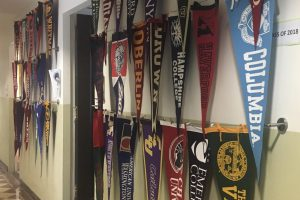 In the college admissions corridor, various pennants hang along the walls representing the past two years where Archer graduates have matriculated. For people of color, the harmful effects of microagressions surrounding the college admissions process has become an area of discomfort and discouragement, as topics such as race, athletics and socioeconomic status arise.