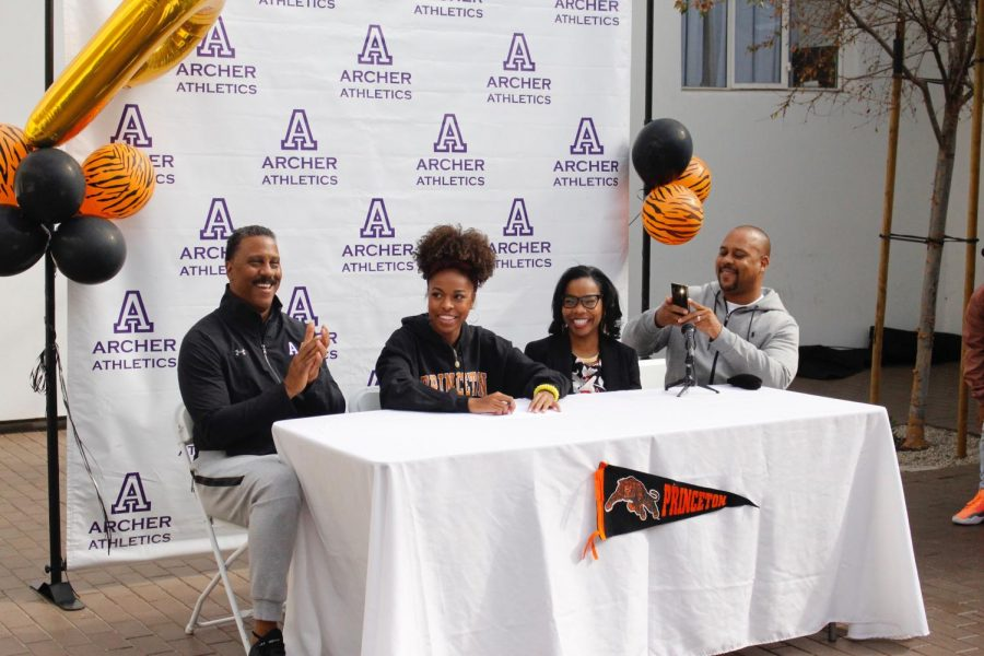 Senior Nia Mosby signs her National Letter of Intent to play Division 1 track and field at Princeton University. Mosby signed her letter alongside Archer varsity track and field coach Phil Smith and her parents, Potesia Perry and Anthony Mosby.