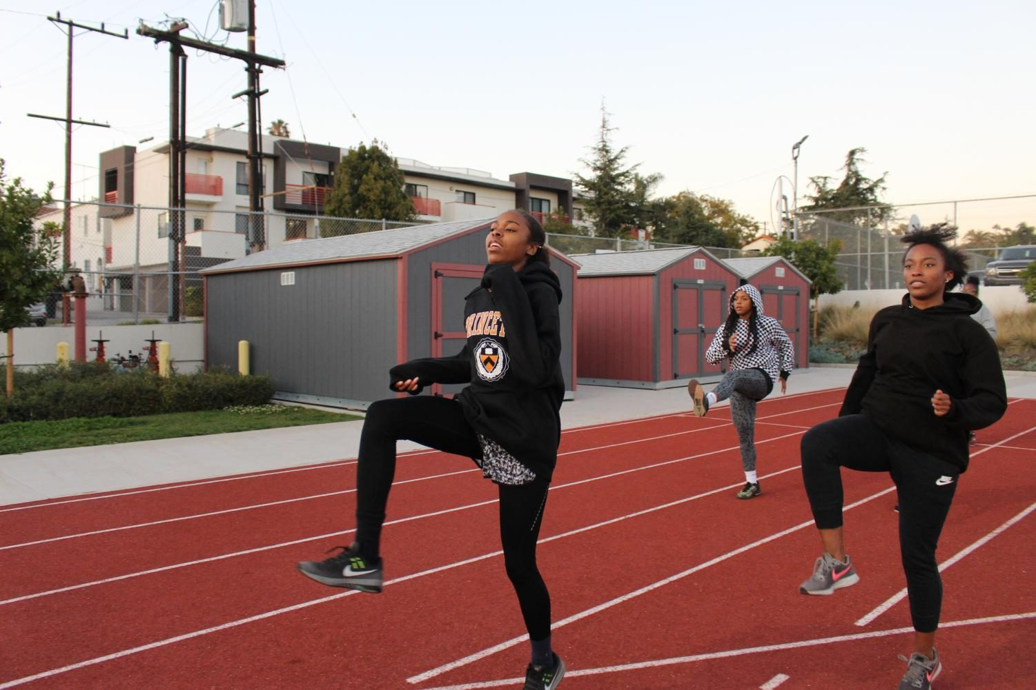 "Nia Mosby, Giana Parks and Hailey Adams warm up during one of their after school practices. The entire team feels ""excited"" to officially begin their season this year and begin competing. Their first liberty league meet took place on March 3."