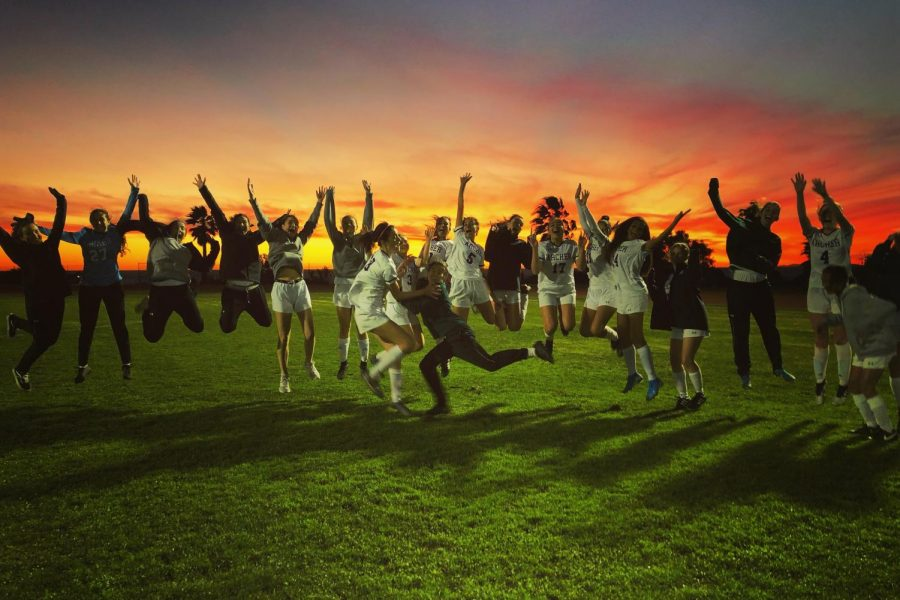 The varsity soccer team celebrates after winning a game against Malibu High School. The team's victories have advanced them to quarterfinals of the CIF Southern Section.