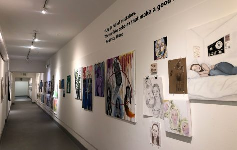Art pieces hang on the art hallway walls. Thirty Archer students were recognized by the Scholastic Art and Writing Awards, the longest-running and most prestigious national program for teens in grades seven to 12.