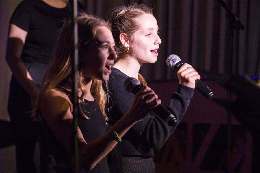 Soloists+Amelia+Lewinson+and+Rose+Morris+perform+middle+school+a+cappella%27s+arrangement+of+Stitches+at+the+Winter+Concert%2C+which+took+place+in+January.+The+middle+school+a+cappella+group+is+fairly+new%2C+but+has+already+managed+to+impress+many+of+their+upper+school+classmates.++