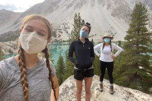 Sophomore Eliza Tiles and seniors Norah Adler and Sophia Stevens socially distance backpack in the John Muir Wilderness in California. Tiles says backpacking is a great way to enjoy the beauty of the outdoors, but she urges hikers to follow Leave No Trace principles.