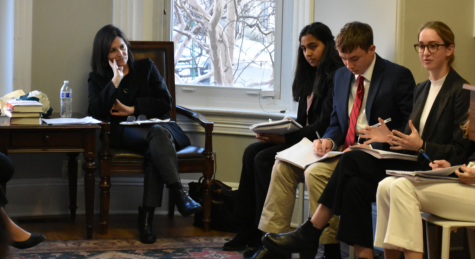 Senior Billi Newmyer speaks at a meeting with Lissa Muscatine (Hillary Clinton