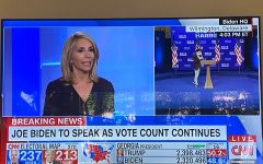 On the television screen, CNN anchors discuss the continuation of counting votes and possible outcomes. The 2020 Presidential Election commenced on Nov. 3 and continues today as ballots are still being counted in states such as Georgia, Michigan and Pennsylvania.