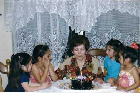 The image features my grandmother's 80 birthday dinner with two of my cousins, my sister and myself surrounding her. My grandmother