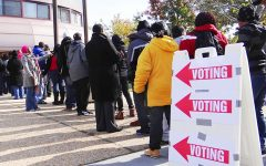 People stand in line to vote with voting sign displayed in Washington, D.C. Donald Trump issued remarks on the election and mail-in ballots on Nov. 5 stating that